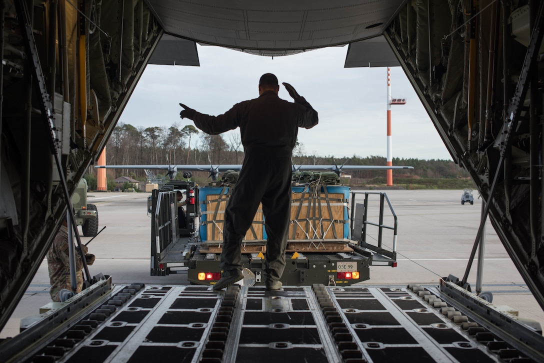 A U.S. Air Force Airman assigned to the 37th Airlift Squadron guides a mobile aerial porter before loading a C-130J Super Hercules aircraft during Exercise Agile Wolf at Ramstein Air Base, Germany, Dec. 17, 2019. Agile Wolf tests the 435th CRS's ability to coordinate and operate mobility operations with the 37th AS for the first time at Ramstein Air Base. (U.S. Air Force photo by Staff Sgt. Devin Nothstine)