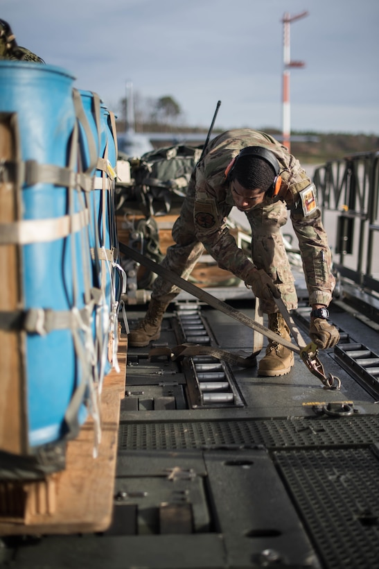 U.S. Air Force Senior Airman Kenneth Saunders, 435th Contingency Response Squadron mobile aerial porter, secures a pallet during Exercise Agile Wolf at Ramstein Air Base, Germany, Dec. 17, 2019. The 435th provides U.S. Air Forces in Europe's primary expeditionary aerial port capability and performs initial airfield operations enabling rapid standup of combat operations anywhere in the European theater. (U.S. Air Force photo by Staff Sgt. Devin Nothstine)