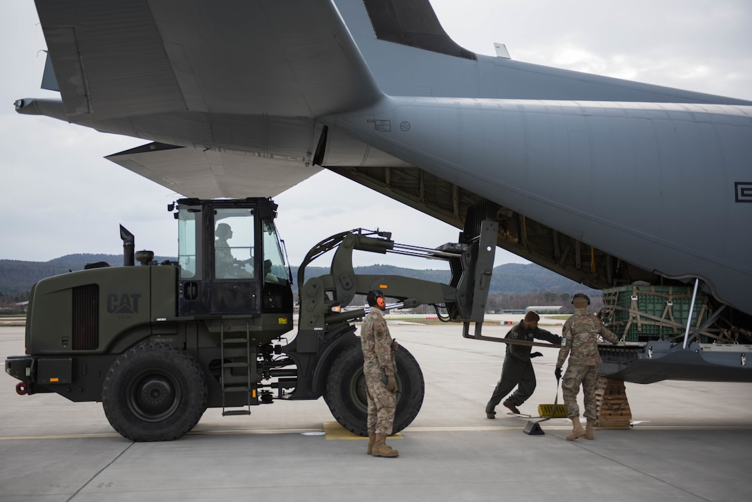 U.S. Air Force Airmen assigned to the 435th Contingency Response Squadron load small cargo pallets onto a 37th Airlift Squadron C-130J Super Hercules aircraft during Exercise Agile Wolf at Ramstein Air Base, Germany, Dec. 17, 2019. Agile Wolf tests the 435th CRS's ability to coordinate and operate mobility operations with the 37th AS for the first time at Ramstein Air Base. (U.S. Air Force photo by Staff Sgt. Devin Nothstine)