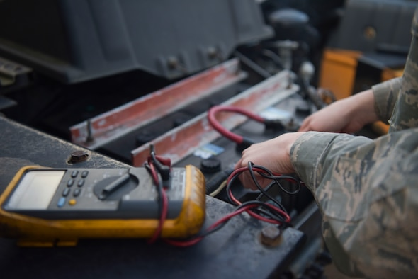 Staff Sgt. Garrison West, 100th Logistics Readiness Squadron mission generating vehicle equipment maintenance supervisor, checks the battery box of a semi-truck assigned to the 100th LRS, Jan. 6, 2019, at RAF Mildenhall, England. The vehicle maintenance shop keeps the daily maintenance up-to-date on the all the vehicles assigned to the 100th LRS ranging from oil changes and battery checks to tire replacements. (U.S. Air Force photo by Senior Airman Alexandria Lee)