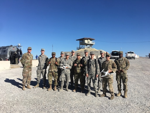 Air Force Airmen who operated directed energy, or DE, weapons during the Army's Maneuver and Fires Integrated Experiment, or MFIX, October 2019, at Fort Sill, Oklahoma. Using high energy laser and high power microwave technologies, the DE weapons defeated a variety of unmanned aerial systems as part of an airbase air defense experiment. (U.S. Army photo by MFIX team)