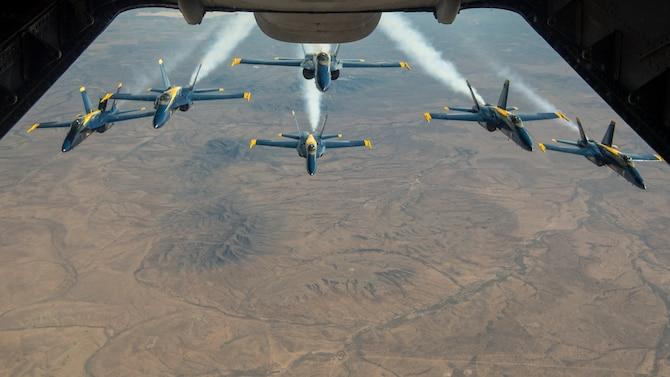 The U.S. Navy Blue Angels fly in formation after being refueled by a KC-10 Extender operated by the 78th Air Refueling Squadron, 514th Air Mobility Wing, Joint Base McGuire-Dix-Lakehurst, N.J., Jan. 3, 2020. Members from the 78th ARS flew a sortie to refuel the U.S. Navy Blue Angels as well as ship cargo from Travis Air Force Base, Calif., to Joint Base Pearl Harbor-Hickam, Hawaii. (U.S. Air Force photo by Senior Airman Ruben Rios)