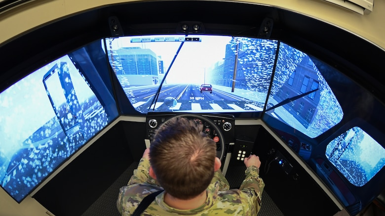 Staff Sgt. Andrew Bagley, training validation and operation NCOIC for the 75th Logistics Readiness Squadron, practices driving in rain on the unit's new vehicle training simulator.  Drivers can use the state-of-the-art simulator to practice on about 30 different vehicles in nearly every driving condition imaginable.   (U.S. Air Force photos by Cynthia Griggs)