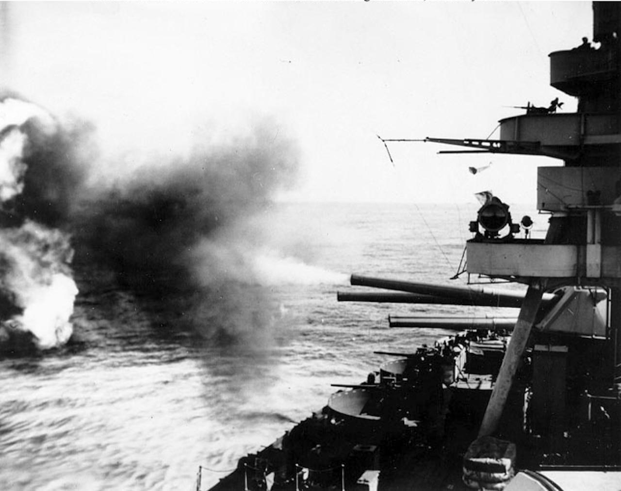 A battleship fires guns.