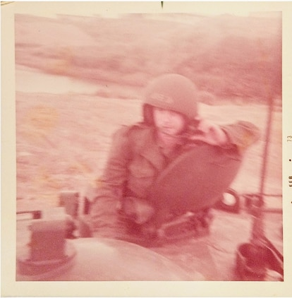 """Then-Lance Cpl. Tommy """"TJ"""" Pittman rides in a Landing Vehicle Tracked P5, one of many predecessors to the Corps' upcoming Amphibious Combat Vehicle, in this photo from February 1973.  Pittman served the amphibious assault community for nearly 50 years, first as an enlisted amphibious vehicle operator for 24 years, then as a logistician with the Advanced Amphibious Assault program office at Program Executive Officer Land Systems for another 24 years. Pittman retired from federal civil service in December 2019. (Courtesy photo from Tommy Pittman)"""