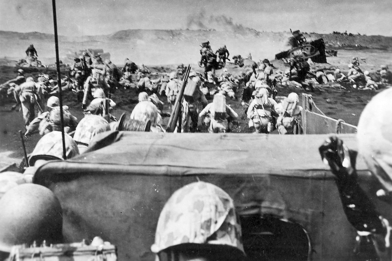 Marines land on Iwo Jima.