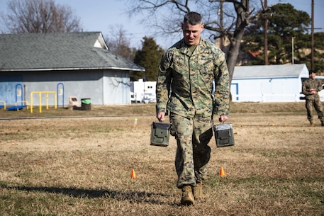 U.S. Marines with the Chemical Biological Incident Response Force (CBIRF) conduct a combat fitness test (CFT) aboard Naval Support Activity Indian Head, Maryland on Dec 20, 2019. Marines are required to run their CFT to test their overall fitness would be in a combat situation. (U.S. Marine Corps photo by SSgt Kristian Karsten/released)
