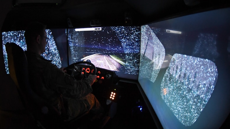 Staff Sgt. Andrew Bagley, training validation and operation NCOIC in the 75th Logistics Readiness Squadron, practices night driving in snowy conditions with the unit's new vehicle training simulator. Drivers can use the state-of-the-art simulator to train for nearly any driving condition imaginable and on nearly 30 different vehicles.  (U.S. Air Force photos by Cynthia Griggs)