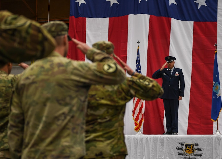 Commander receives his final salute from his Airmen.