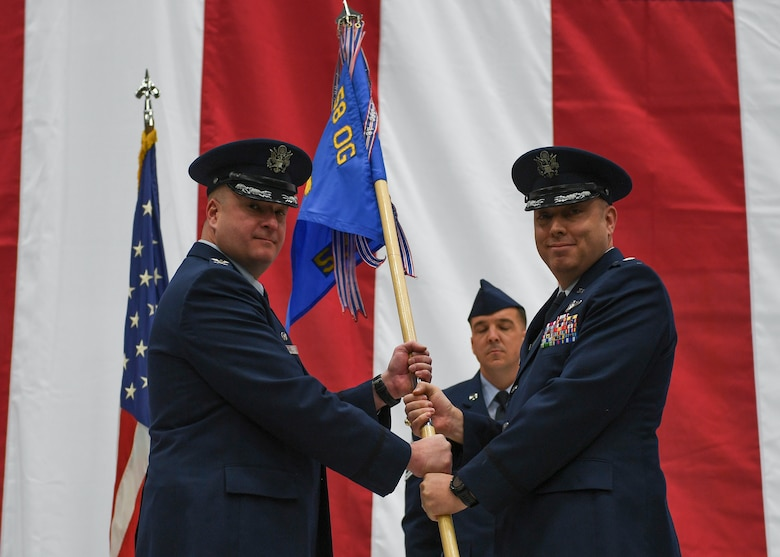 Passing of squadron flag during a change of command ceremony.