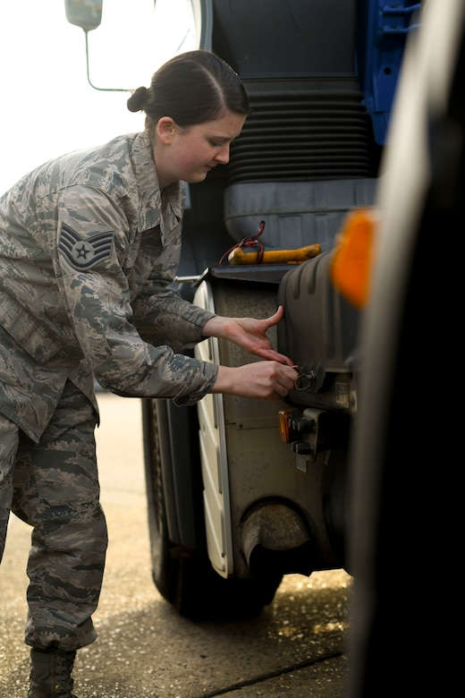 Staff Sgt. Garrison West, 100th Logistics Readiness Squadron mission generating vehicle equipment maintenance supervisor, opens the battery box of a semi-truck assigned to the 100th LRS, Jan. 6, 2019, at RAF Mildenhall, England. The vehicle maintenance shop keeps the daily maintenance up-to-date on the all the vehicles assigned to the 100th LRS ranging from oil changes and battery checks to tire replacements. (U.S. Air Force photo by Senior Airman Alexandria Lee)