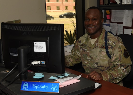 U.S. Air Force Tech. Sgt. Derwin Finley, 315th Training Squadron military training leader, smiles at his desk in the 316th TRS MTL office on Goodfellow Air Force Base, Texas, Dec. 13, 2019. Finley has been assigned to Goodfellow for two years and has been enlisted in the Air Force for 12 years. (U.S. Air Force photo by Airman 1st Class Abbey Rieves)