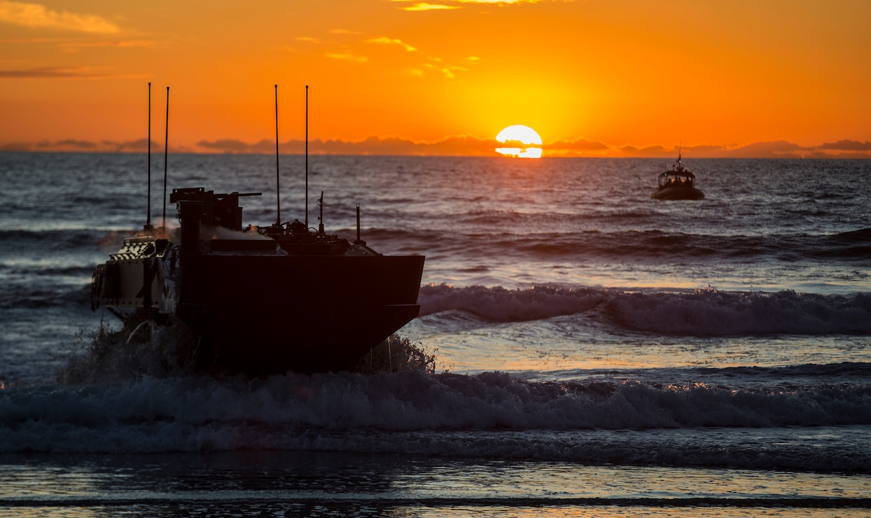 U.S. Marines with Amphibious Vehicle Test Branch, Marine Corps Tactical Systems Support Activity, drive a new Amphibious Combat Vehicle ashore during low-light surf transit testing at AVTB Beach on Marine Corps Base Camp Pendleton, California, Dec. 18.