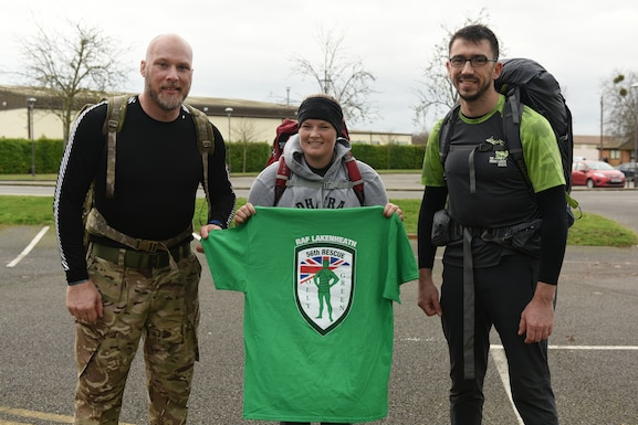 Barry Wall, Occupational Safety and former British Army infantryman, Tech. Sgt. Josh Rogers and Staff Sgt. Kacy Huddleston, Weapon Systems instructors assigned to the 372 Training Squadron Detachment 16 ruck eight miles carrying 56 lbs to raise funds and awareness in memory of the fallen 56th Rescue Squadron HH-60G Pave Hawk crew of Jolly-22, at Royal Air Force Lakenheath, England, Jan. 2, 2020. On Jan. 7, 2014, Capt. Sean Ruane, Capt. Christopher Stover, Tech. Sgt. Dale Mathews and Staff Sgt. Afton Ponce were killed when their helicopter crashed while performing a low-level training mission on the Norfolk coast. (U.S. Air Force photo/ Staff Sgt. Rachel Maxwell)