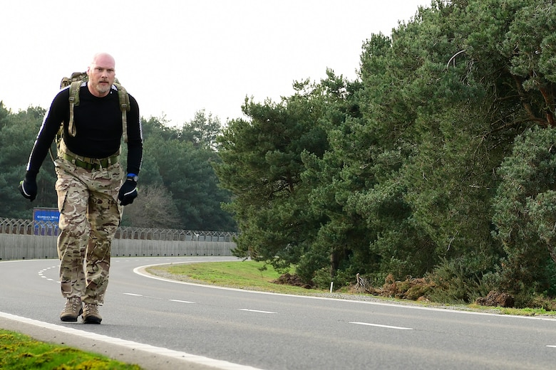 Barry Wall, Occupational Safety and former British Army infantryman,rucks eight miles carrying 56 lbs to raise funds and awareness in memory of the fallen 56th Rescue Squadron HH-60G Pave Hawk crew of Jolly-22, at Royal Air Force Lakenheath, England, Jan. 2, 2020. On Jan. 7, 2014, Capt. Sean Ruane, Capt. Christopher Stover, Tech. Sgt. Dale Mathews and Staff Sgt. Afton Ponce were killed when their helicopter crashed while performing a low-level training mission on the Norfolk coast. (U.S. Air Force photo/ Master Sgt. Matthew Plew)