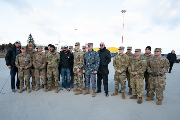 "Service members at Mihail Kognalniceanu Air Base, Romania, greet USO Talent as they arrive as part of the Chairman's USO New Year's Tour 2020, Jan. 6, 2020. Vice Chairman of the Joint Chiefs of Staff Gen. John E. Hyten and Senior Enlisted Advisor to the Chairman Ramon ""CZ"" Colon-Lopez host the Chairman's USO Tour on behalf of Chairman of the Joint Chiefs of Staff Gen. Mark A. Milley to bring Washington Nationals Aaron Barrett and Adam Eaton, comedians Scott Armstrong and Matt Walsh, actor Brad Morris, country music band LoCash, MMA Fighters Illima-Lei Macfarlane and Felice Herrig; and DJ J Dayz to show service members in the U.S. European area of responsibility that America remembers them and values their service."