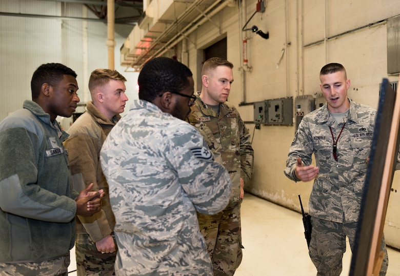 Maintenance Airmen with the 131st and the 509th Bomb Wings at Whiteman Air Force Base, Missouri, discuss improved maintenance phase inspection process on Dec. 11, 2019. The Airmen explained their findings as part of the Phase Innovation Showcase which consisted of five stations that Airmen rotated through to learn about the new 14-day phase inspection. (U.S. Air Force photo by Airman 1st Class Christina Carter)