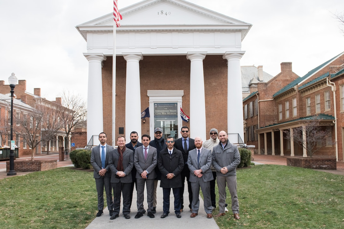 Members of the Kuwaiti Military Engineering Projects Office and program managers from the U.S. Army Corps of Engineers Middle East District pose for a photo outside the historic courthouse in Winchester, VA where the District headquarters is located.