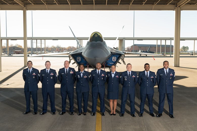 Group photo of Airmen in front of a jet