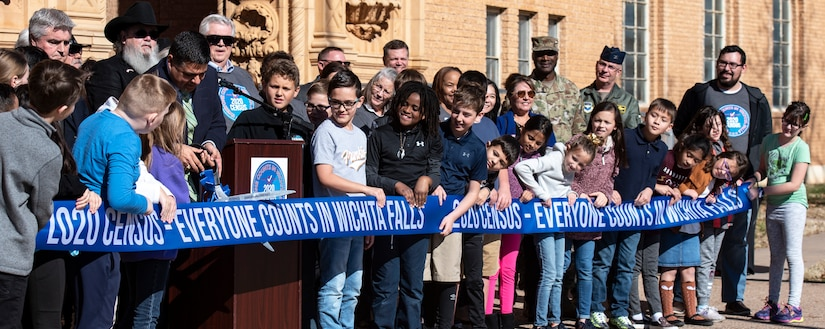 Wichita Falls Mayor Stephen Santellana cuts a ribbon at the 2020 Census launch event at the Memorial Auditorium in Wichita Falls, Texas, Jan. 7, 2020. After the speeches at the event, attendees of the event counted down as Santellana and fourth grade WFISD students officially cut the 2020 census ribbon to kick-off the count phase. (U.S. Air Force photo by Senior Airman Pedro Tenorio)