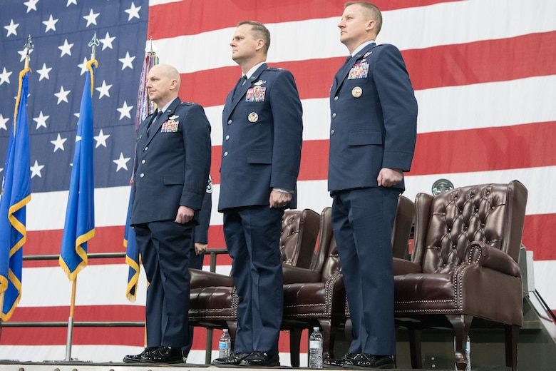 From left, Maj. Gen. Sam C. Barrett, 18th Air Force commander, Col. Joel Safranek, outgoing 436 Airlift Wing commander and  Col. Matthew Jones, incoming 436th AW commander, stand at attention during the 436th AW Change of Command ceremony Jan 7, 2020, at Dover Air Force Base, Del. Safranek relinquished command to Jones in a ceremony attended by friends, family, members of Team Dover, local civic leaders and distinguished visitors. (U.S. Air Force photo by Mauricio Campino)