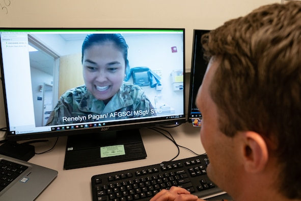 2nd Lt. Erik Baskin, Systems Flight commander, 90th Health Care Operations Squadron, and Master Sgt. Renelyn Pagan, Operational Medicine flight chief, 90th Operations Medical Readiness Squadron, demonstrate how the new video medical care system will work. Maj. Michael Vernale, Mental Health Flight commander worked with the 90th Missile Wing LaunchWERX agency to launch the idea as part of an ongoing effort to innovate the Air Force to meet the demands of tomorrow. The plan is to install the capability in each missile alert facility. (U.S. Air Force photo by Joseph Coslett)