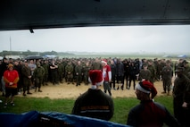 U.S. Marines with Marine Corps Air Station (MCAS) Futenma gather around Col. David Steele, commanding officer, for the opening remarks on MCAS Futenma, Okinawa, Japan, Dec. 6, 2019. The Jingle Bell challenge is a time for Marines who are far away from home to build unit morale during the holiday season. (U.S. Marine Corps photo by Cpl. Sarah  Stegall)