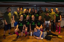 U.S. Marines with Marine Rotational Force-Europe 20.1, Marine Forces Europe and Africa, pose for a picture with a local Bardu soccer team during the Juleturneringa in Setermoen, Norway, Dec. 28, 2019.