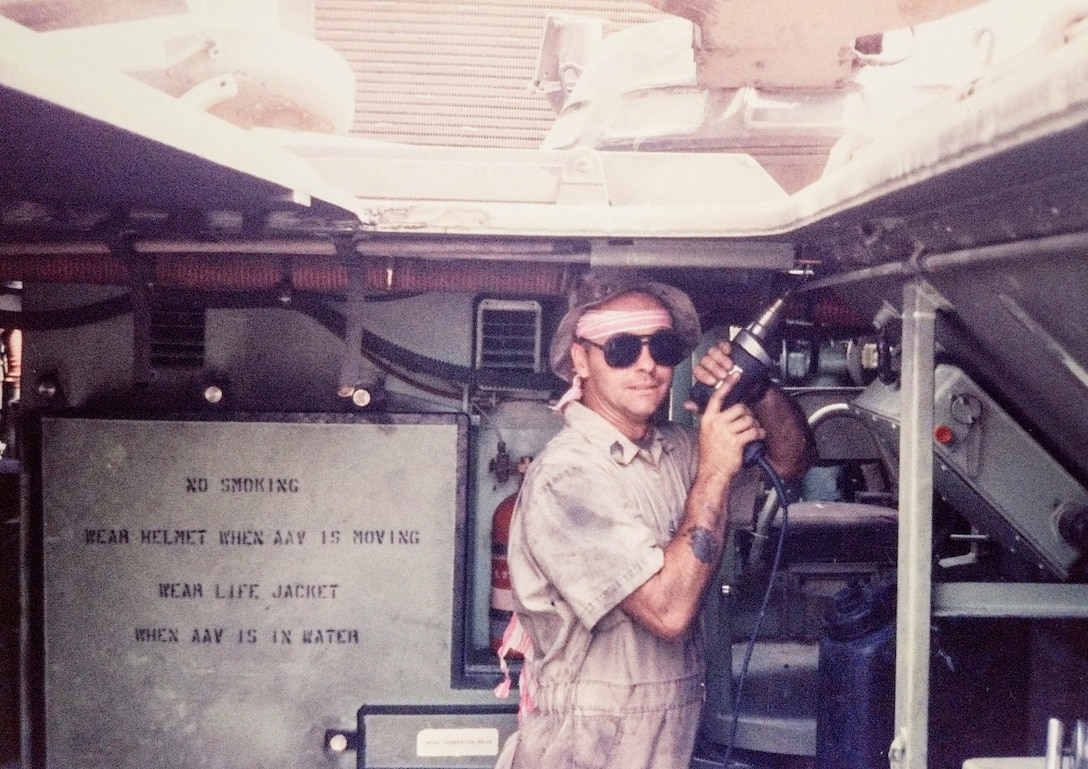 """Master Sgt. Tommy """"TJ"""" Pittman repairs an Assault Amphibious Vehicle in 1991."""