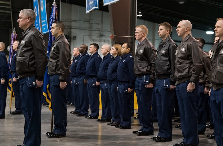 Team Dover members stand in formation during the 436th Airlift Wing Change of Command ceremony Jan. 7, 2020, inside the 436th Aerial Port Squadron on Dover Air Force Base, Del. During the ceremony, Col. Joel Safranek relinquished command to Col. Matthew Jones. (U.S. Air Force photo by Roland Balik)