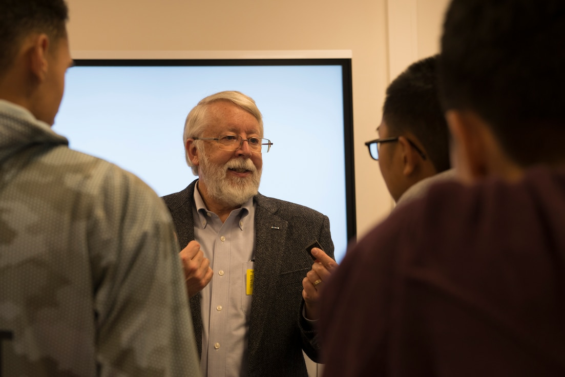 Jay Simpson, former Technical Director and Program Manager for the CIA, meets with students for hands-on activities during an educational event hosted by the Air Force Association and Kaiserslautern High School Science, Technology, Engineering and Mathematics program at Kapaun Air Station, Germany, Dec. 16, 2020. Simpson wrote several books on optical fiber technology and is responsible for 80 publications and 15 patents in the field.