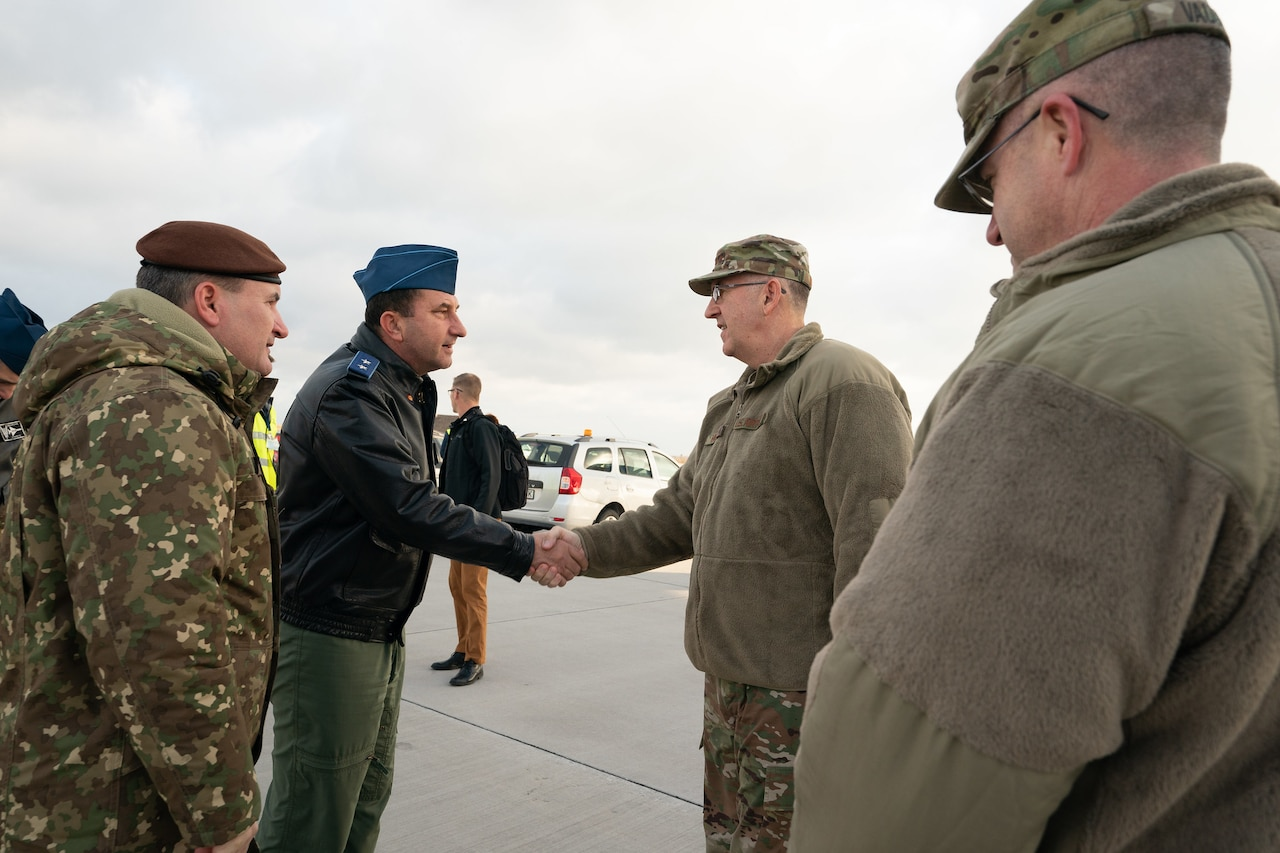 General officers from Romania and the United States shake hands.
