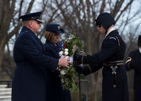 Air Force Office of Special Investigations Commander, Brig. Gen. Terry L. Bullard and Command Chief Master Sgt. Karen F. Beirne-Flint present the AFOSI wreath to a member of the 3rd Infantry Regiment (The Old Guard) for placement at the Tomb of the Unknown Soldier at Arlington National Cemetery, Va., Jan. 7, 2020.  (U.S. Air Force photo by Staff Sgt. Jeremy Mosier, SAF/PAI)