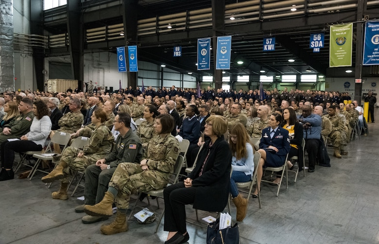 Congressional delegates, civic leaders, family, guests, friends and Team Dover members observe the 436th Airlift Wing Change of Command ceremony Jan. 7, 2020, inside the 436th Aerial Port Squadron on Dover Air Force Base, Del. Presiding officer for the ceremony was Maj. Gen. Sam C. Barrett, 18th Air Force commander. (U.S. Air Force photo by Roland Balik)