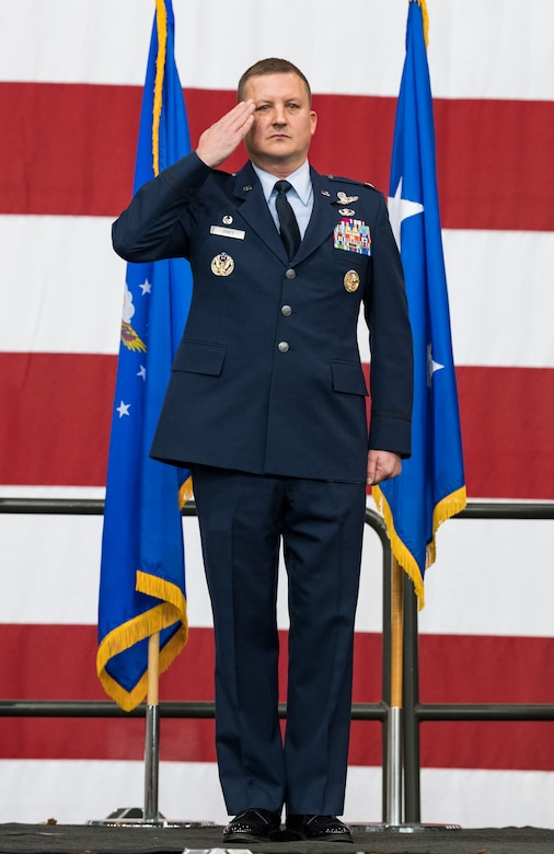 Col. Matthew Jones, 436th Airlift Wing commander, receives his first salute from a formation of Team Dover members during the 436th AW Change of Command ceremony Jan. 7, 2020, inside the 436th Aerial Port Squadron on Dover Air Force Base, Del. Jones became the wing's 35th commander. (U.S. Air Force photo by Roland Balik)