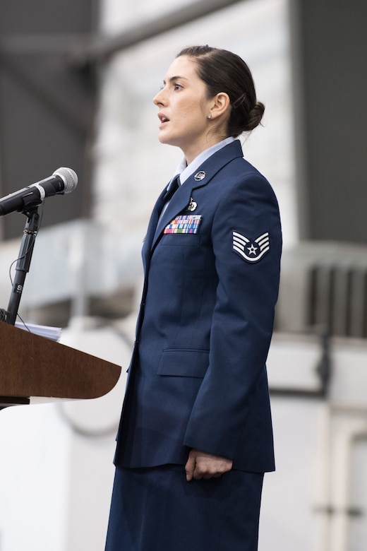 Staff Sgt. Alicia Garcia, 436th Force Support Squadron Advanced Leadership School instructor, sings the national anthem during the 436th AW Change of Command ceremony Jan 7, 2020, at Dover Air Force Base, Del. Col. Joel Safranek relinquished command to Col. Matthew Jones in a ceremony officiated by 18th Air Force commander Maj. Gen. Sam C. Barrett. (U.S. Air Force photo by Mauricio Campino)