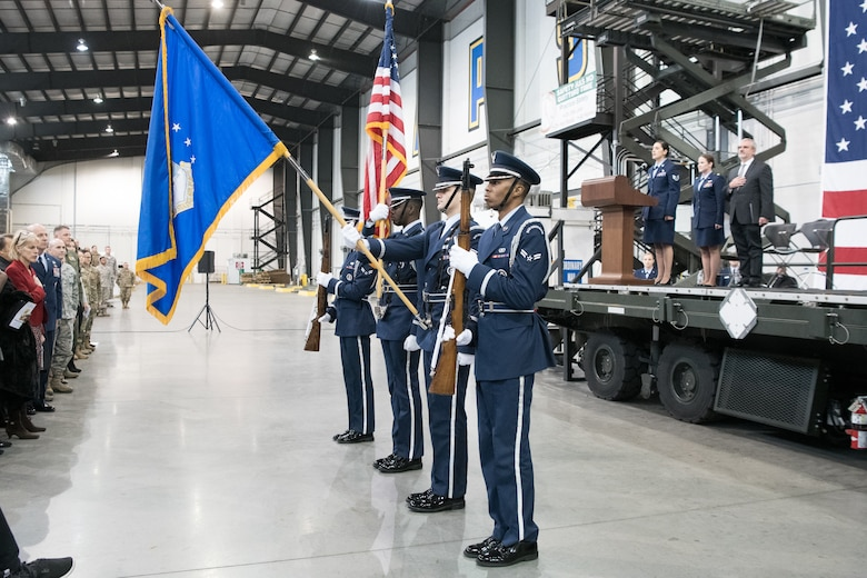 The Dover Air Force Base Honor Guard presents the colors during the 436th AW Change of Command ceremony Jan 7, 2020, at Dover Air Force Base, Del. More than 100 Airmen from Dover participated in the ceremony. (U.S. Air Force photo by Mauricio Campino)