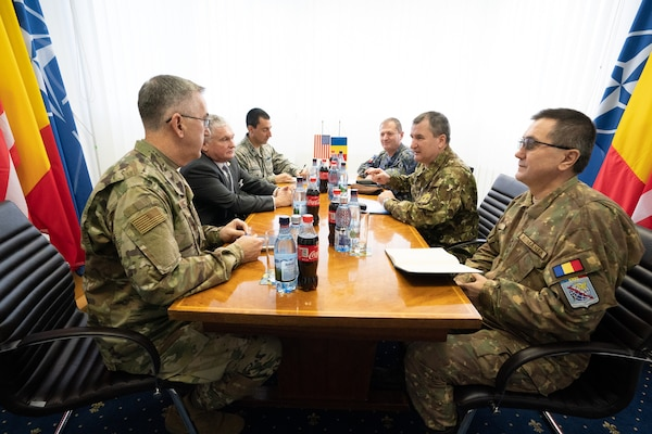 Vice Chairman of the Joint Chiefs of Staff Gen. John E. Hyten meets with Romanian Chief of the Defense Staff Lt. Gen. Daniel Petrescu during a visit to Mihail Kognalniceanu Air Base, Romania, as part of the Chairman's USO New Year's Tour 2020, on Jan. 7, 2020.