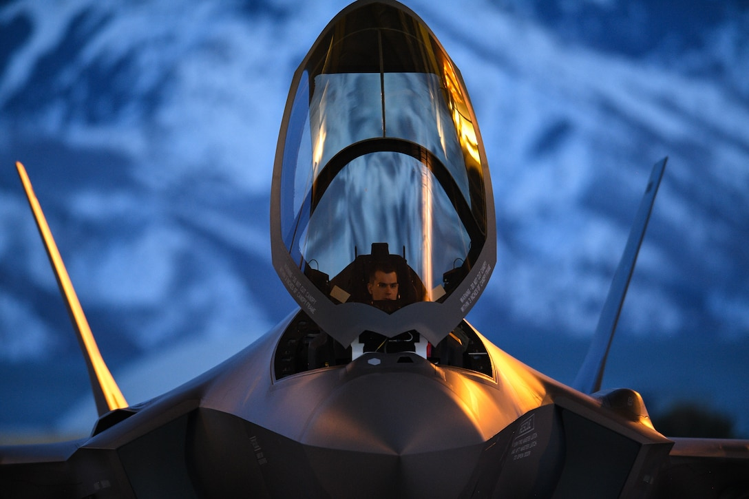 A pilot prepares to launch an F-35A Lightning II during night-flying operations