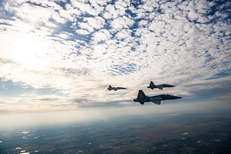 Pilots soar through the sky in a T-38C Talon
