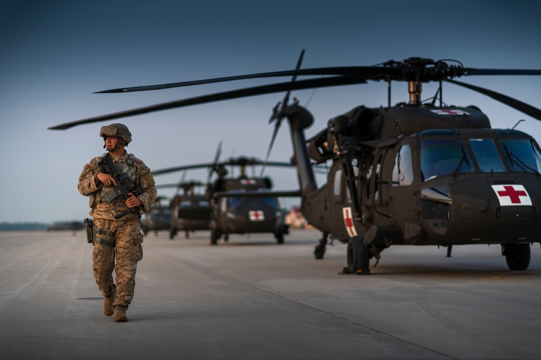 Security forces specialist walks the flightline