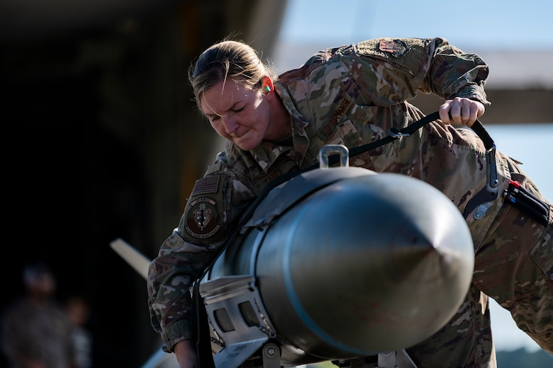 Weapons load crew chief, conducts a weapons-load demonstration