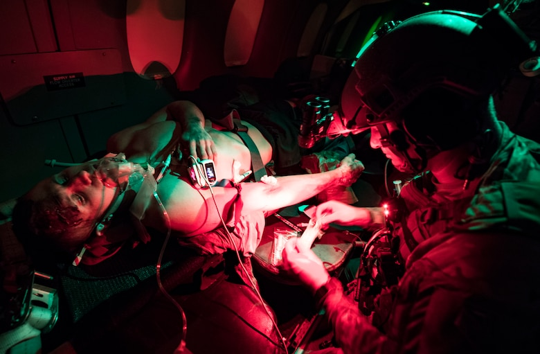 A U.S. Air Force special operations force medical element works with Royal Danish Air Force medical personnel to treat simulated patients