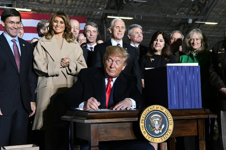 President Donald Trump signs S.1790, the National Defense Authorization Act for Fiscal Year 2020