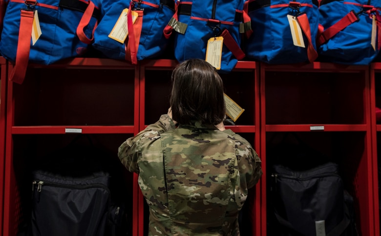 Photo of Airman putting labels on lockers