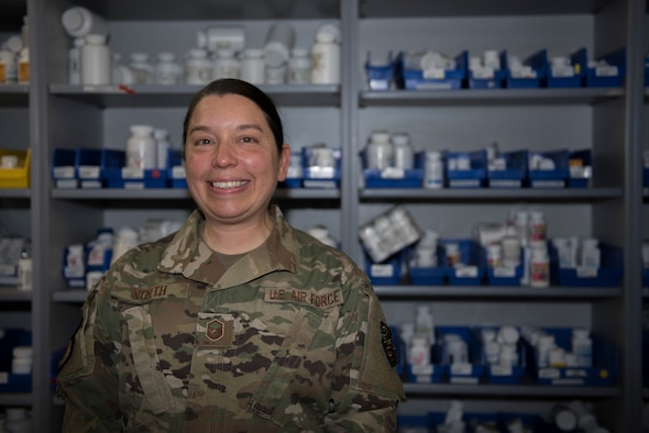 U.S. Air Force Master Sgt. Andrea North, 60th Medical and Diagnostics Therapeutic Squadron satellite pharmacy section chief, stands in front of the satellite pharmacy medicine wall Jan. 7, 2020, at Travis Air Force Base, California. North was recognized as the 60th Air Mobility Wing Warrior of the Week for her efforts in keeping the pharmacy running during a base power outage Nov. 27, 2019. The Warrior of the Week program recognizes Airmen who have made significant contributions to their unit. (U.S. Air Force photo by Airman 1st Class Cameron Otte)