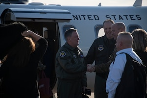 U.S. Air Force Col Matthew Leard, commander of the 97th Air Mobility Wing, and Chief Master Sgt. Randy Kay II, command chief of the 97th AMW, greets Lt. Gen. Brad Webb, commander of Air Education and Training Command,