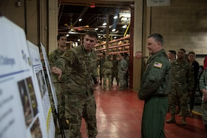 U.S. Air Force Lt. Gen. Brad Webb, commander of Air Education and Training Command, learns more about initiatives happening throughout the 97th Logistics Readiness Squadron.