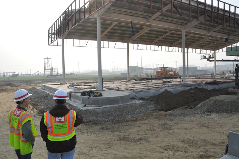 Craig Margrave (left), POL-MCX mechanical engineer, and Michael Merwald, POL-MCX electrical engineer, inspect a retail fueling facility under construction at Camp Humphreys, Korea.  Photo by Greg Etter.