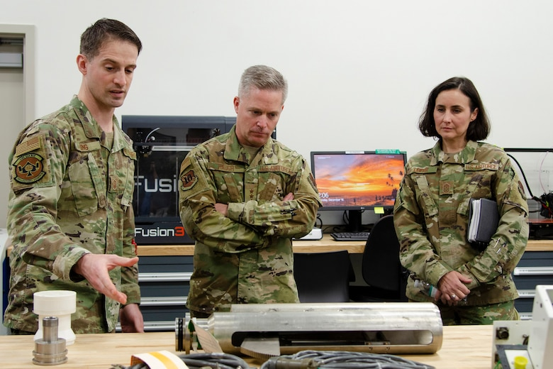 Master Sgt. Joseph King (left), superintendent of maintenance operations at the Air Force Technical Applications Center's Central Repair Facility, explains to 16th Air Force (Air Forces Cyber) Commander Lt. Gen. Timothy Haugh and 16th AF Command Chief Master Sgt. Summer Leifer how the CRF maintains its seismic equipment to execute AFTAC's global nuclear treaty monitoring mission.  The 16th AF leaders visited Patrick AFB, Fla., Dec. 16, 2019.  (U.S. Air Force photo by Susan A. Romano)